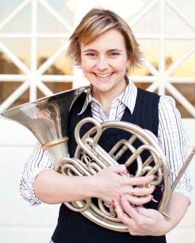 picture of Annie Bosler holding a French horn