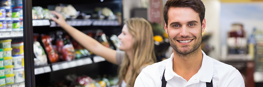 Grocery employee seeking retail management certificates with a blue and white illustration in the background