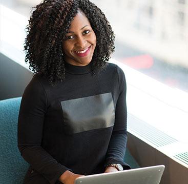 African American Woman Smiling Wearing a Black Shirt