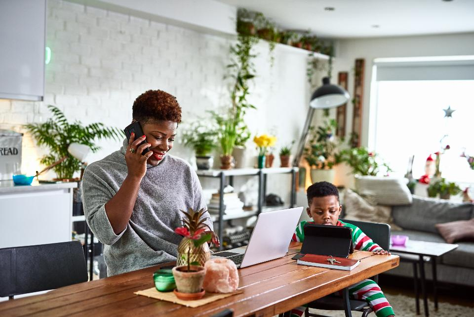 mother and son working and learning from home
