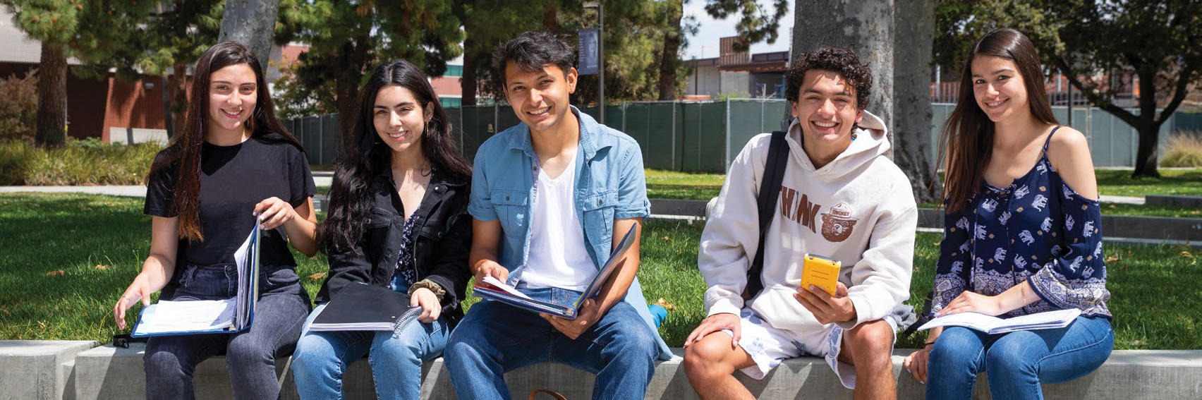 Students sitting on bench